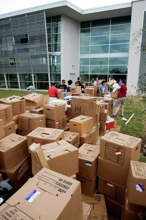 Boxes are stacked in front of the new Carnegie Vanguard High School campus on Saturday as students and parents help tote teachers' supplies into the new campus in Midtown. Inside, construction crews were still finishing up. Photo: J. Patric Schneider / © 2012 Houston Chronicle