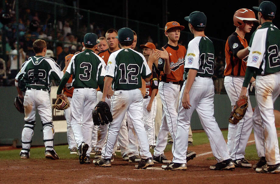 Players from Great Lakes file past New England after New England beat them 4-0, during 2012 Little League World Series game action in South Williamsport, Penn. on Monday August 20, 2012. Photo: Christian Abraham / Connecticut Post