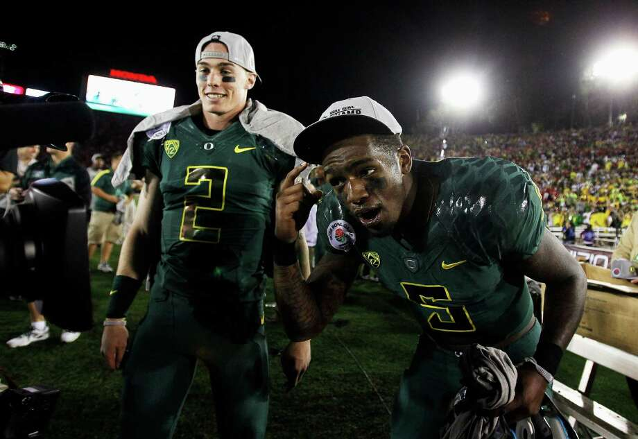 Bryan Bennett #2 (left) and Darron Thomas #5 of the Oregon Ducks celebrate the Ducks 45-38 victory against the Wisconsin Badgers at the 98th Rose Bowl Game on January 2, 2012 in Pasadena, California. Photo: Jeff Gross, Getty Images / 2012 Getty Images