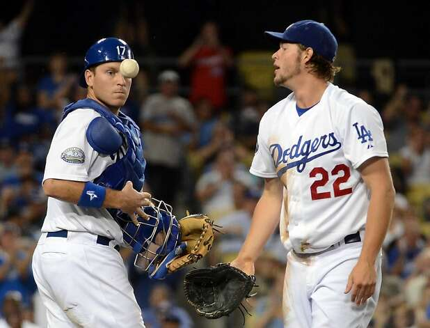Clayton Kershaw #22 and A.J. Ellis #17 of the Los Angeles Dodgers react after a catch for an out of Gregor Blanco #7 of the San Francisco Giants during the third inning at Dodger Stadium on August 20, 2012 in Los Angeles, California.  (Photo by Harry How/Getty Images) Photo: Harry How, Getty Images