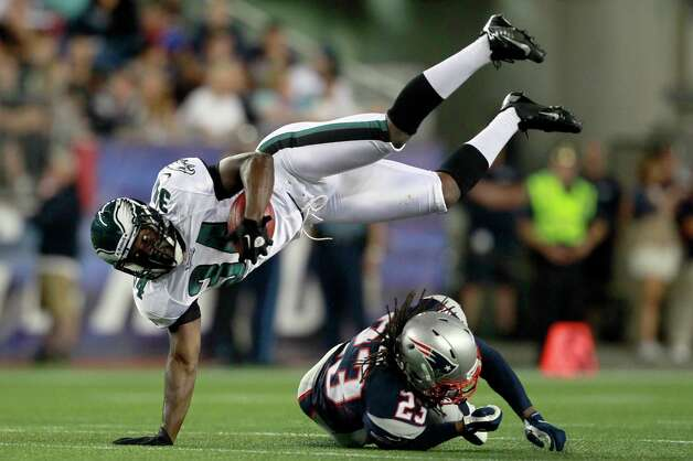 New England Patriots defensive back Marquice Cole upends Philadelphia Eagles running back Bryce Brown, top, during the third quarter of an NFL preseason football game in Foxborough, Mass., Monday, Aug. 20, 2012.(AP Photo/Steven Senne) Photo: Steven Senne