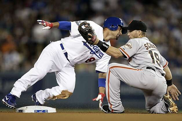 San Francisco Giants second baseman Marcus Scutaro catches Los Angeles Dodgers left fielder Shane Victorino trying to steal second in the third inning Monday, August 20, 2012 at Dodger Stadium in Los Angeles, California. (Luis Sinco/Los Angeles Times/MCT) Photo: Luis Sinco, McClatchy-Tribune News Service