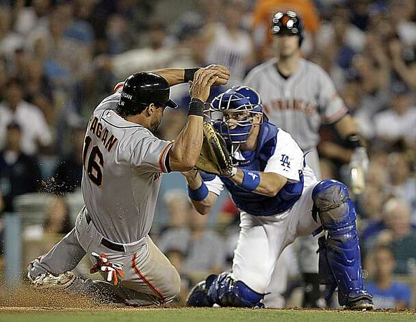 San Francisco Giants center fielder Angel Pagan slides safely  past the tag of Los Angeles Dodgers catcher A.J. Ellis on a controversial play in the sixth inning Monday, August 20, 2012 at Dodger Stadium in Los Angeles, California. (Luis Sinco/Los Angeles Times/MCT) Photo: Luis Sinco, McClatchy-Tribune News Service