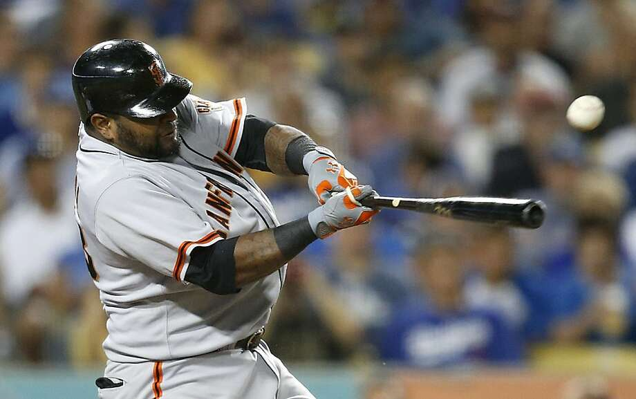 Pablo Sandoval connects on a soft single to left in the sixth inning that scored Angel Pagan with the Giants' second run. Photo: Jae Hong, Associated Press