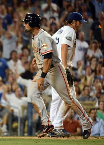 LOS ANGELES, CA - AUGUST 20:  Angel Pagan #16 of the San Francisco Giants reacts to his run for a 2-0 lead in front of Clayton Kershaw #22 of the Los Angeles Dodgers during the sixth inning at Dodger Stadium on August 20, 2012 in Los Angeles, California.  (Photo by Harry How/Getty Images) Photo: Harry How, Getty Images
