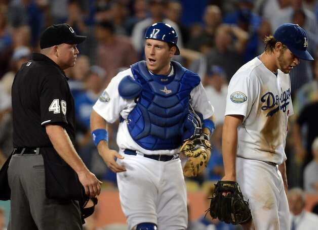 LOS ANGELES, CA - AUGUST 20:  A.J. Ellis #17 and Clayton Kershaw #22 of the Los Angeles Dodgers argue a call at the plate with home plate umpire Ron Kulpa #46 after an Angel Pagan #16 of the San Francisco Giants run for a 2-0 lead during the sixth inning at Dodger Stadium on August 20, 2012 in Los Angeles, California.  (Photo by Harry How/Getty Images) Photo: Harry How, Getty Images