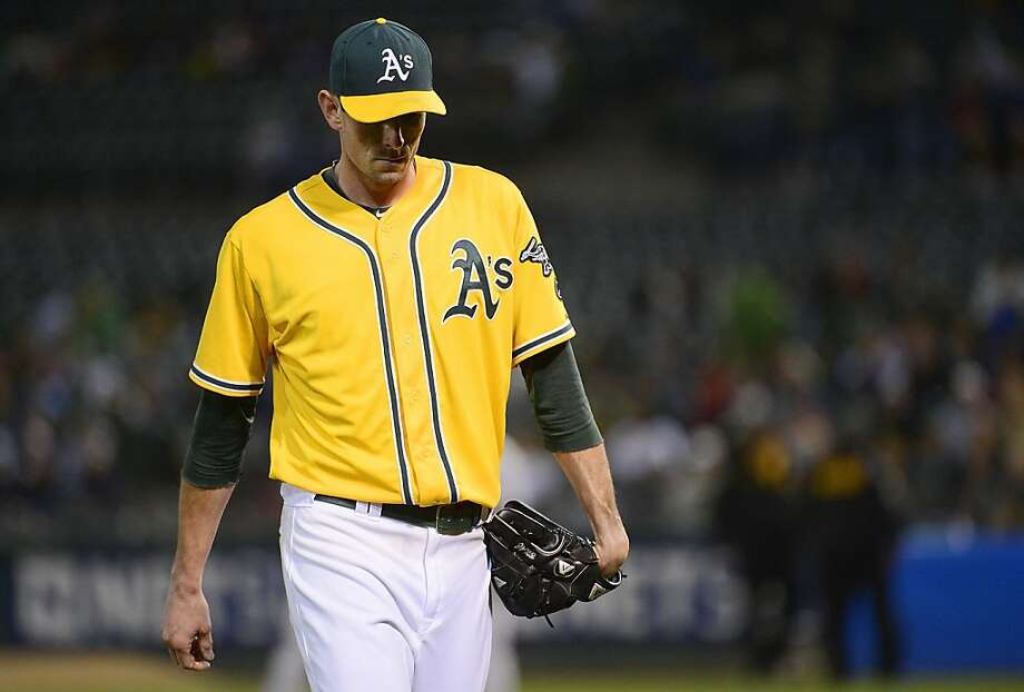 Brandon McCarthy #32 of the Oakland Athletics walks back to the dugout after he was taken out of the game in the fourth inning against the Minnesota Twins at O.co Coliseum on August 20, 2012 in Oakland, California.  (Photo by Thearon W. Henderson/Getty Images) Photo: Thearon W. Henderson, Getty Images