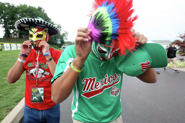 Angel Guerrero, 14, left, and Mauricio Garcia, 16, don their wrestling mask as they arrive to watch Nuevo Laredo, Tamaulipas play against Chinese Taipei in the 2012 Little League World Series in South Williamsport, Pennsylvania, Monday, Aug. 20, 2012. A large group of family and friends from the border city were on hand to watch the team. It is the second time the league has made the series. Photo: Jerry Lara, San Antonio Express-News / © 2012 San Antonio Express-News