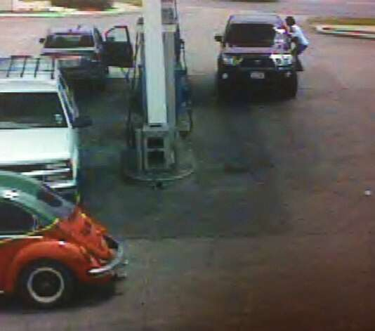 A gas station security camera still introduced into evidence Monday at the death penalty trial of Lorenzo Thompson shows Airman Vanessa Pitts clinging to the side of a stolen truck the defendant was driving after her purse was stolen. Moments later, Pitts was ejected from the truck as it sped away and swerved into another vehicle, causing her death, prosecutors said. Photo: Courtesy