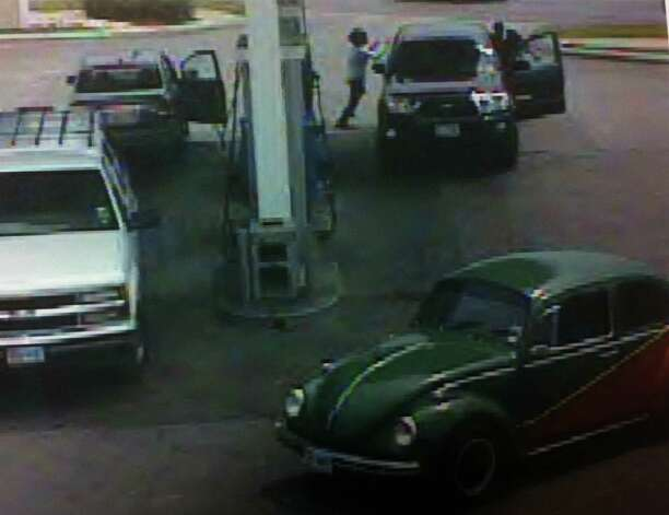 A gas station security camera still introduced into evidence Monday at the death penalty trial of Lorenzo Thompson shows Airman Vanessa Pitts running after him after he took a purse from her car on the opposite side of the pump. Photo: Courtesy
