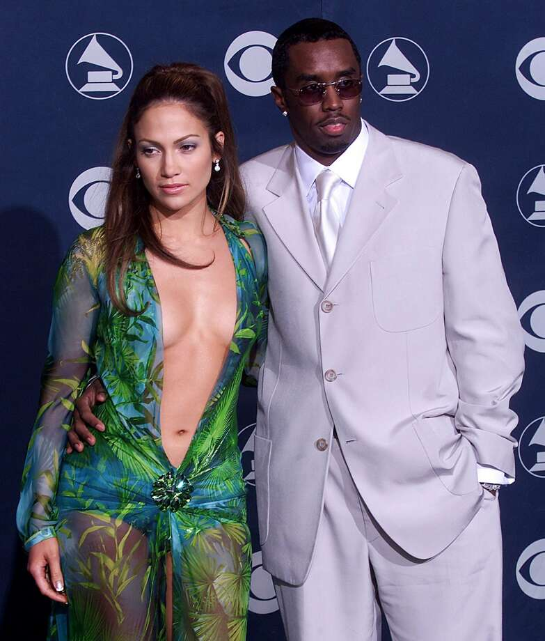 "Bennifer was preceded by Jennifer Lopez-Sean ""Puffy"" Combs pairing, which is always a good reason to look at that famous 2000 Grammys dress again.  (AFP/Getty Images)"