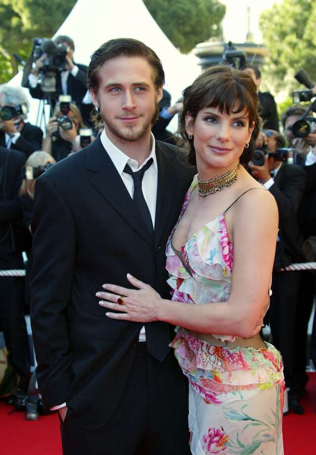 "Ryan Gosling and Sandra Bullock overcame a 16-year age difference to date in 2002, the year their movie ""Murder by Numbers"" premiered.  (AFP/Getty Images)"