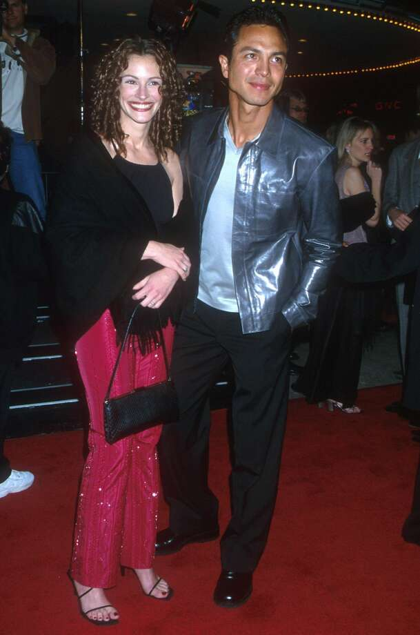 "Julia Roberts found love for a while with Benjamin Bratt, pictured at the 2000 premiere of ""Erin Brockovich."" (Brenda Chase Online USA Inc./Liaison Agency)"