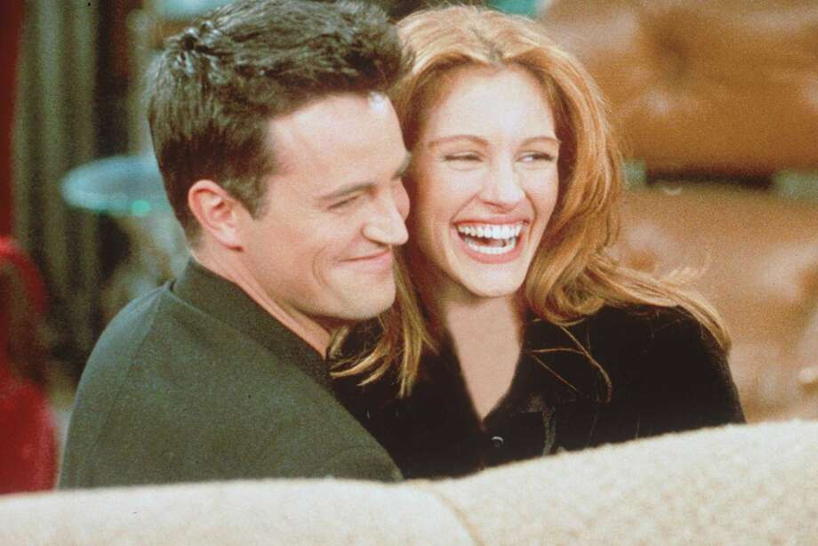 "Then Julia Roberts hooked up with Matthew Perry, after guest-starring on a ""Friends"" episode that aired after the Super Bowl in 1996.  (Getty Images / Getty Images)"