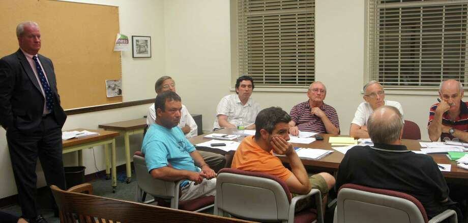 Members of the Representative Town Meeting's  Finance and Employee Compensation committees on Monday review a proposal to offer non-pension retirement benefits to non-union municipal employees. At left is town Finance Director Gary Conrad. Photo: Paul Schott / Westport News