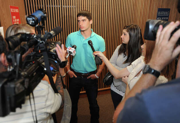 Aaron Ashworth, son to Fred Ahsworth, addresses the media Monday after the sentencing of Dillon Dwight Schlegel for the attempted murder of his father. Schlegel received 30 years imprisonment for the January incident that occurred at the Jefferson County Jail. Photo taken Monday, August 20, 2012. Guiseppe Barranco/The Enterprise Photo: Guiseppe Barranco, STAFF PHOTOGRAPHER / The Beaumont Enterprise