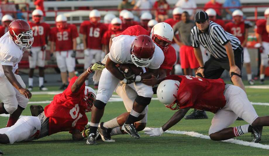 A Jasper running back looks for running room against Marshall. Photo: Jason Dunn
