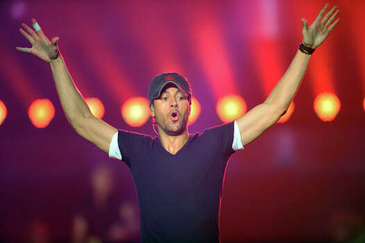 In this photo provided by the Las Vegas News Bureau, Enrique Iglesias performs at Mandalay Bay Events Center in Las Vegas Saturday, August 18, 2012. (AP Photo/Las Vegas News Bureau, Brian Jones) Photo: Brian Jones, Associated Press / Las Vegas News Bureau