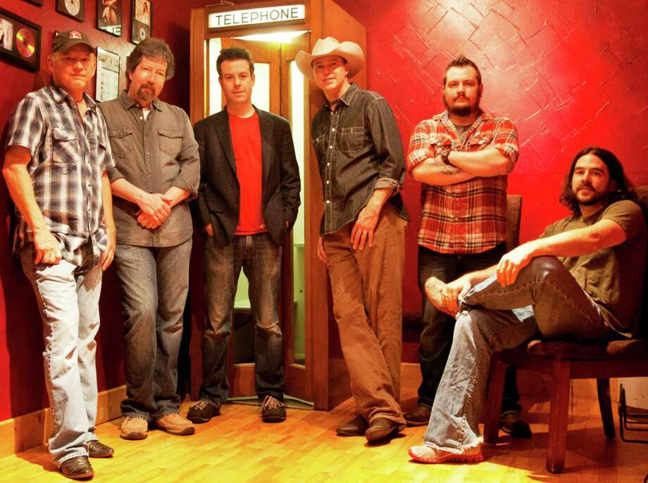 "The reunited Texas Music band Coodder Graw -- from left, Paul Baker, bass guitar; Kelly Turner, lead guitar; Kelly Test, drums; Matt Martindale, vocals and guitar; Jon ""Fish"" Hunt, rhythm guitar; Nick Worley, fiddle and mandolin. -- is playing a few dates in 2012. Photo: Courtesy Photo"