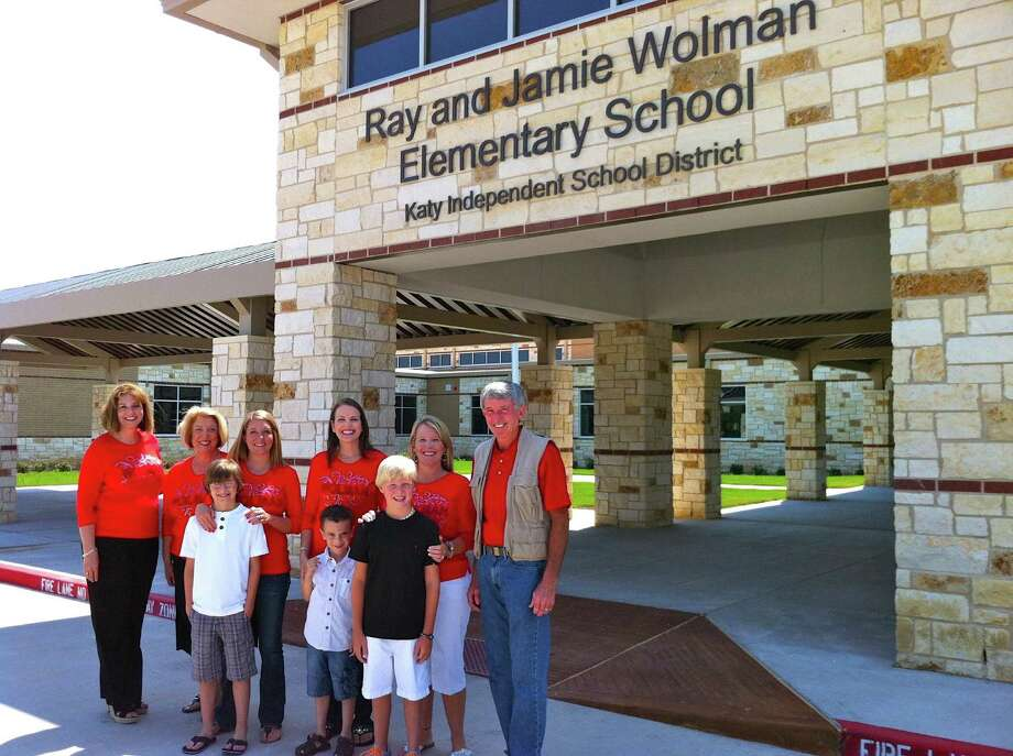 Wolman Elementary School Principal Kelly Ricks, left, welcomes the      school's namesakes Ray Wolman, right, and Jamie Wolman, second from left,      along with the three Wolman teachers who live in Firethorne and have      children who will attend the school. The teachers and their children, from      left, are: Angie and Sean Sticker, Lisa and Connor Campbell and Andrea and      Gaven Tryon.