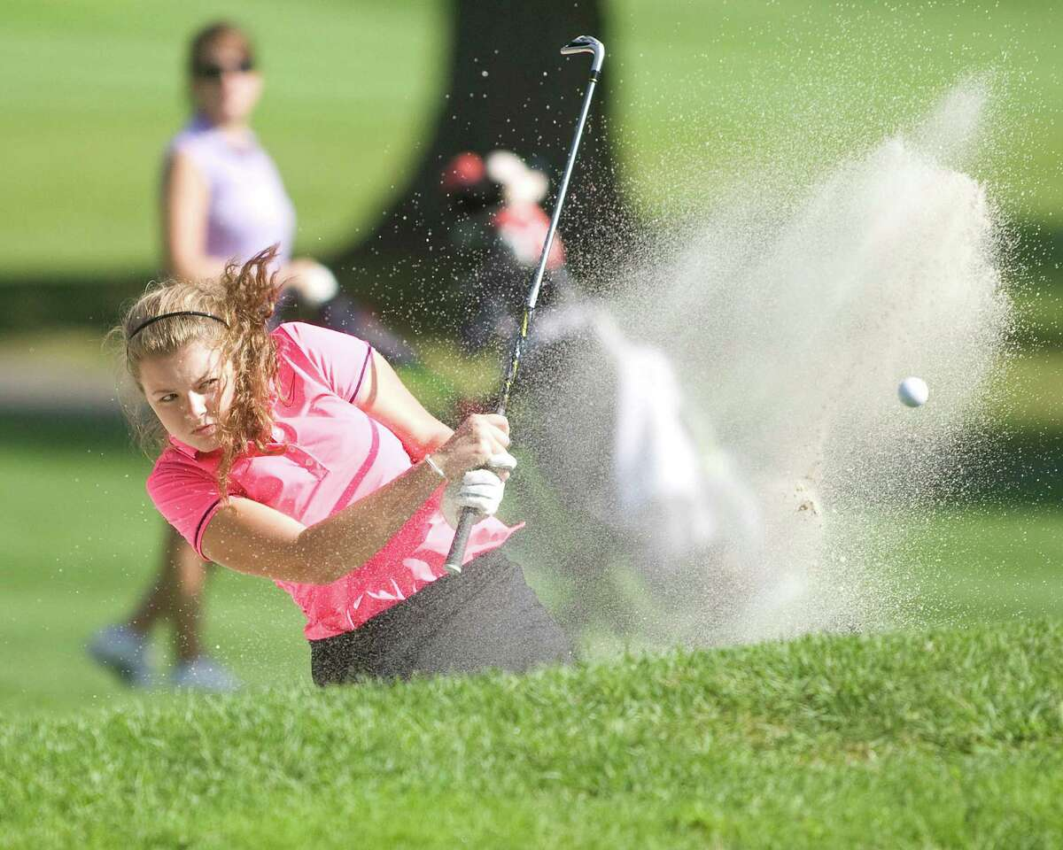 Sam Steichen, 17, of Danbury blasts out of a sand trap during play in the Fran McCarthy Junior Golf Tournament Tuesday at Richter Park Golf Course in Danbury.