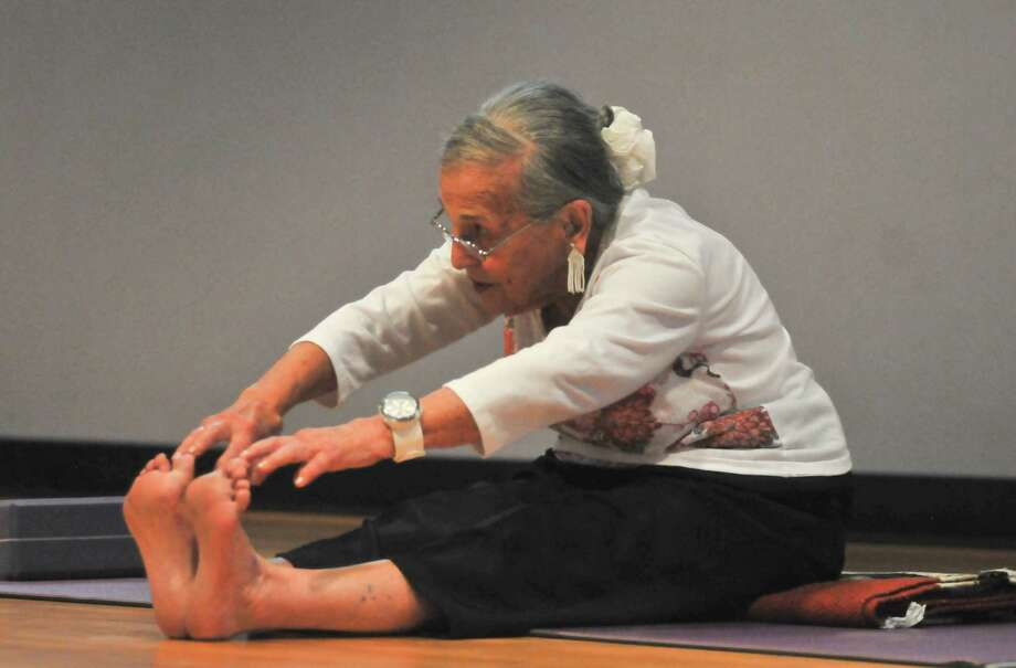 "Esther Vexler, 94, known as ""the grandmother of yoga in San Antonio,"" teaches a class.  Photo: Robin Jerstad, For The Express-News"