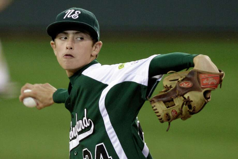 Determination etched on his face, Fairfield American's Will Lucas delivers against New Castle, Ind. Monday night. His no-hitter has put the 12 year old in a national-media spotlight. Photo: Gene J. Puskar, Associated Press / AP