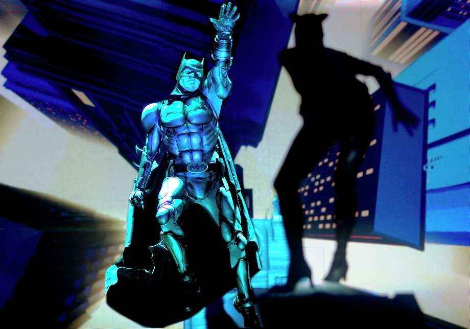 "Batman and Catwoman in a scene from the arena touring show ""Batman Live"" Photo: Courtesy Batman Live"
