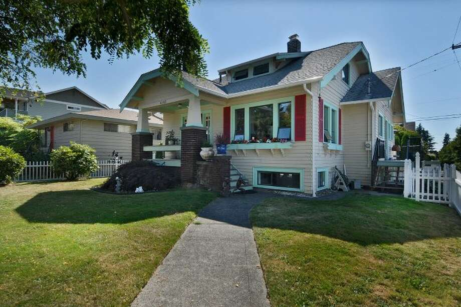 The Genesee neighborhood is convenient to the commercial heart of West Seattle, with some classic Craftsman homes from the 1920s. Here are three for less than $450,000, starting with 4103 42nd Ave. S.W. The 2,570-square-foot house, built in 1925, has three bedrooms, 1.75 bathrooms, an updated kitchen, a rec room, a front porch and a big back deck on a 3,750-square-foot corner lot with a picket fence. It's listed for $410,000. Photo: Courtesy Karen Lavallee/Windermere Real Estate