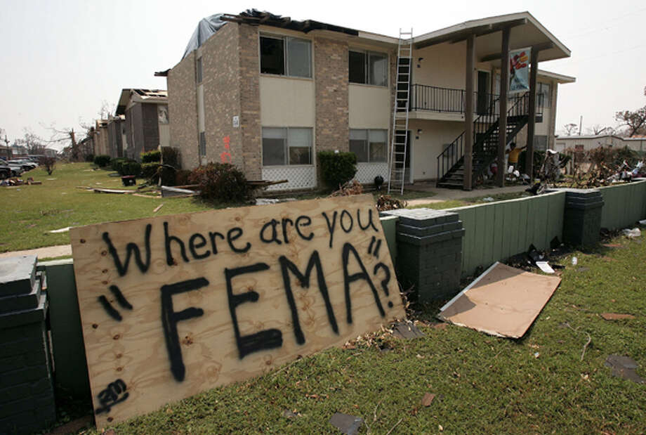 Shown: Residents of an apartment complex damaged by Hurricane Katrina have placed a sign outside their homes in Biloxi, Mississippi, September 4, 2005.  Credit: Win McNamee/Getty Images Photo: .