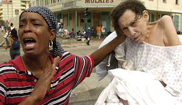 """Screaming """"My patient is not dead, my patient is not dying! All she needs is oxygen!"""" Sarah Johnson seeks help Sept. 1, 2005, at the Ernest N. Morial Convention Center for the woman she cares for, whom she declined to identify. Photo: ."""