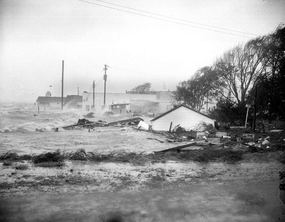 Hurricane Hazel shatters boats and buildings in Swansboro, N.C., as the storm lashes the Atlantic Seaboard Oct. 15, 1954. Hazel came ashore in the Carolinas and from there slogged north through Pennsylvania and New York and into Canada with heavy rains producing severe floods. Today, Hazel would cost $20 billion.  Photo: .