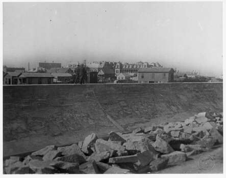 Damage to Galveston, Texas during the 1900 Storm. In the years following the September 8, 1900 hurricane which struck Galveston and brought a huge tidal wave crashing through the the low-lying island, killing thousands and destroying much of city, a concrete seawall was built and the entire island raised above sea level using six dredges to pump sea sand under remaining buildings.  This photo is from around 1906. CREDIT: Rosenberg Library, Galveston, Tx. Photo: .