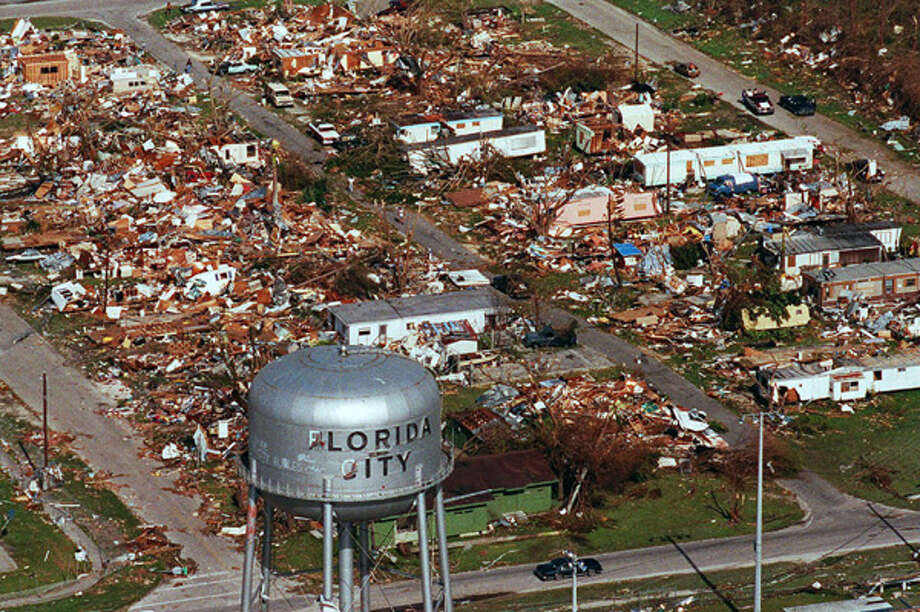 This water tower, a landmark at Florida City, Fla., still stands Aug. 25, 1992, over the ruins of the Florida coastal community that was hit by the force of Hurricane Andrew. The loss of life and property caused by Hurricane Katrina in 2005 is expected to far exceed the wrath of the record-setting Hurricane Andrew, which struck in 1992. Photo: .