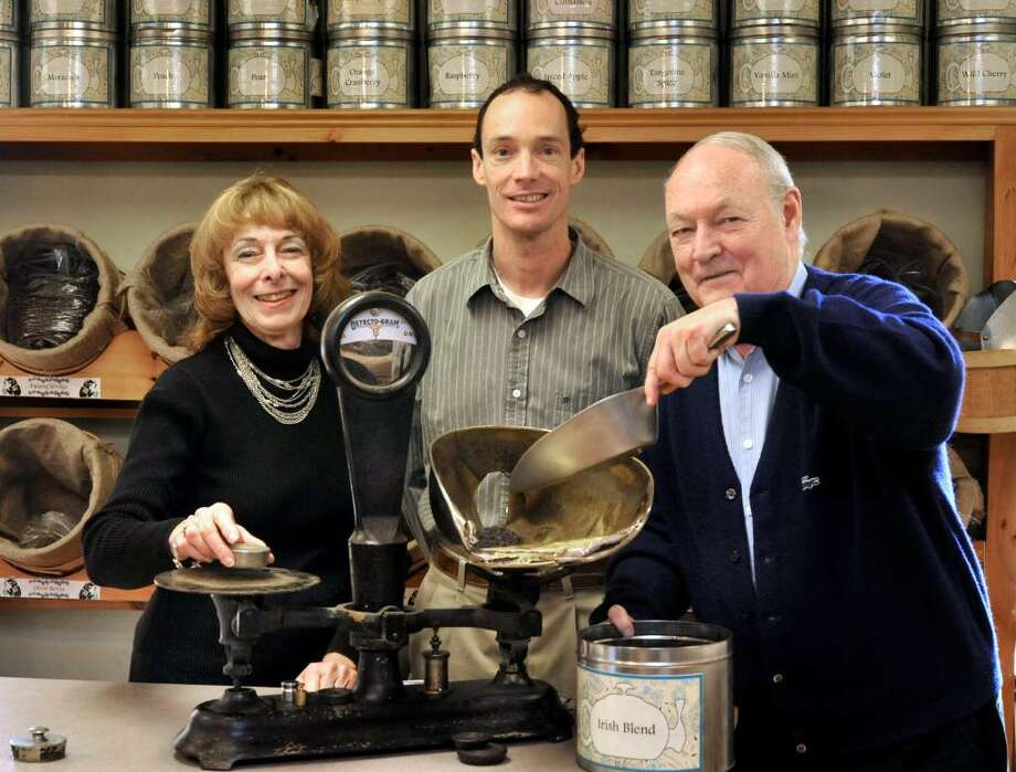 Joan, left, Jim Jr. and Jim Harron Sr., behind the counter at Simpson & Vail, Inc., in Brookfield, on Friday, Nov.20,2009. Photo: Michael Duffy / The News-Times