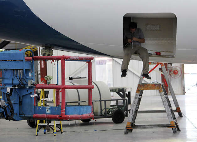 An AERIA Luxury Interiors employee performs work on a private Boeing 757 on Wednesday, August 8, 2012. AERIA is a subsidiary of ST Aerospace San Antonio. AERIA is a new niche operation for ST Aerospace that customizes aircraft to the needs of the private aircraft owners. ST Aerospace has traditionally been a maintenance facility for commercial aircraft and has been in San Antonio since 2002 when the company acquired operations from Dee Howard Aircraft Maintenance. Photo: Kin Man Hui, SAN ANTONIO EXPRESS-NEWS / ©2012 San Antonio Express-News
