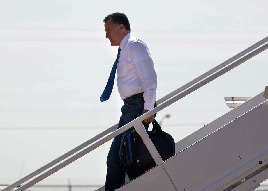 Republican presidential candidate, former Massachusetts Gov. Mitt Romney arrives at Wilson Air Center to attend fundraising events, Tuesday, Aug. 21, 2012, in Houston, Texas.  (AP Photo/Evan Vucci) Photo: Evan Vucci, Associated Press / AP