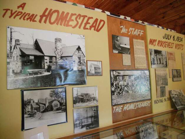 A display board at Cumberland Homesteads Tower Museum in Tennessee depicts 1930s life at the CCC project community. Photo: Robin Soslow, For The Express-News