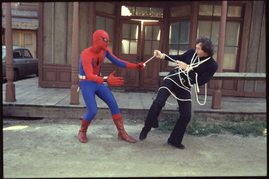 "50-years of Spider-Man- The web-flying superhero made his first debut in the comic book ""Amazing Fantasy #15,"" in 1962. In this photo American actor Nicholas Hammond (left), as the costumed superhero Spider-man, wrangles a villain in an episode of the CBS television series 'The Amazing Spider-Man' entitled 'The Deadly Dust,' April 1978. The series was based on a long-running comic book, developed by Stan Lee and Steve Ditko. Photo: CBS Photo Archive, Getty Images / 2007 CBS WORLDWIDE INC"