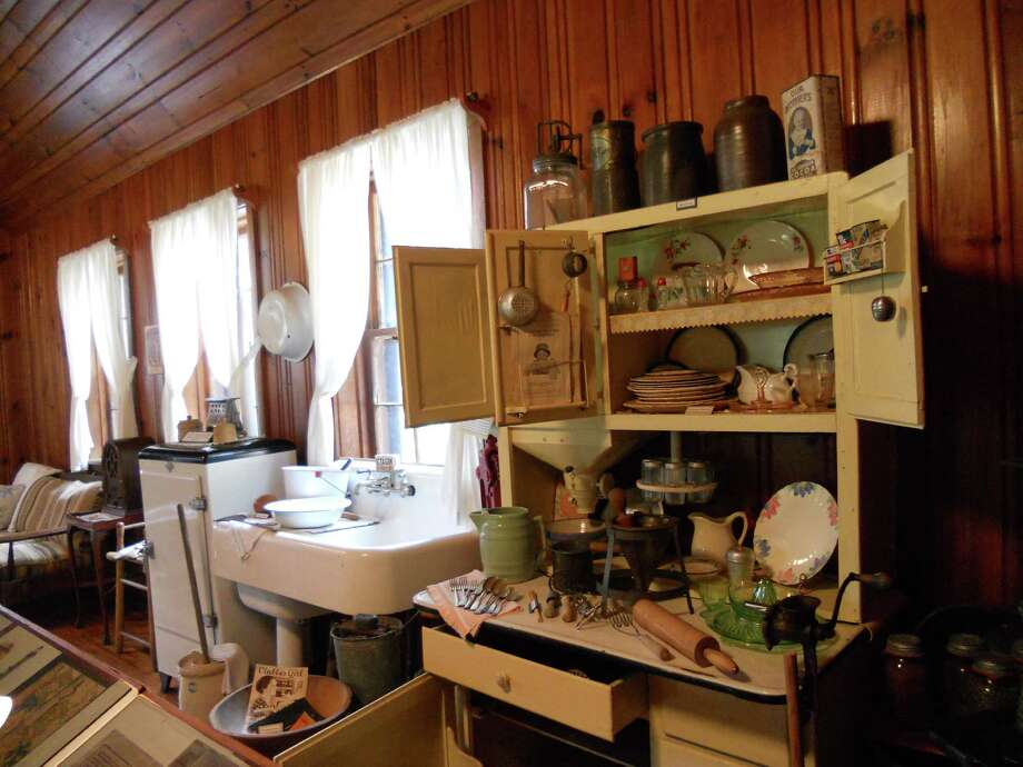 Kitchen furnishings and cookware help museum visitors imagine life at the 1930s homesteads. Photo: Robin Soslow, For The Express-News