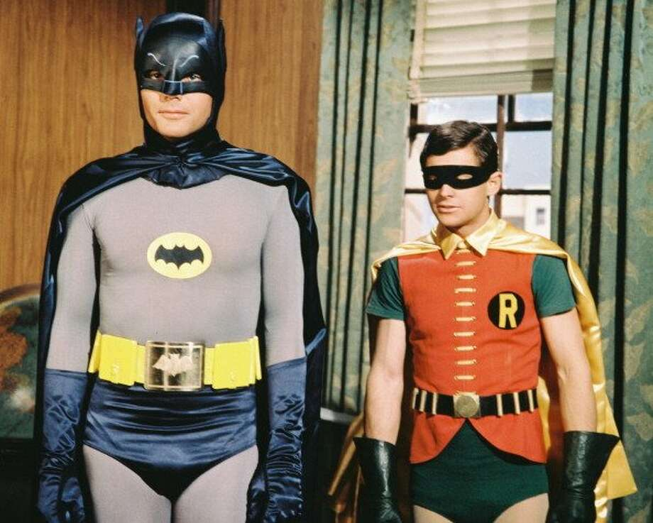 "73-years of Batman- Batman who also goes under the secret identity of Bruce Wayne, made his first comic appearance in ""Detective Comics #27."" In this file photo American actor Adam West, born 1928, appears in the early popular television series ""Batman,"" alongside his partner Robin played by actor Burt Ward, 1966.  (Getty Images)"