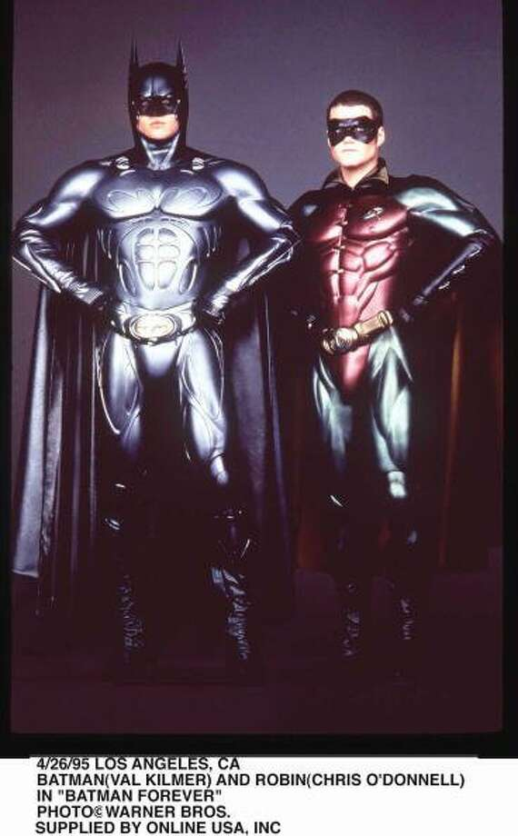 "73-years of Batman- Batman who also goes under the secret identity of Bruce Wayne, made his first comic appeareance in ""Detective Comics #27."" Pictured in this photo is actors Val Kilmer who played Batman in the 1995 film ""Batman Forever,"" and his partner in crime Robin, played by actor Chris O'Donnell. (Getty Images)"