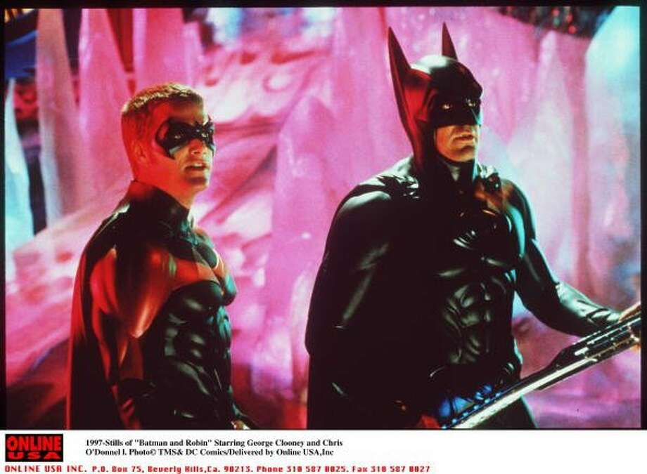 "73-years of Batman- Batman who also goes under the secret identity of Bruce Wayne, made his first comic appeareance in ""Detective Comics #27."" Pictured is a still shot from the set of ""Batman and Robin,"" starring George Cloney as Batman, and Chis O'Donnell as his partner Robin, May 27, 1997. (Getty Images)"