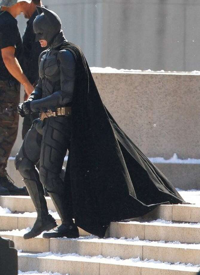 "73-years of Batman- Batman who also goes under the secret identity of Bruce Wayne, made his first comic appearance in ""Detective Comics #27."" In this file photo Christian Bale stands around in between scenes during the filming of the Batman film, ""Dark Knight Rises,"" July 31, 2011. (Getty Images)"