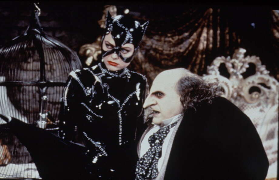"72-years of Cat Woman- The feline character made her first debut in the comic book ""Batman"" in the Spring of 1940. Pictured is Michelle Pfeiffer as Catwoman and Danny DeVito as the Penguin in the film 'Batman Returns,' 1992. Photo: Time & Life Pictures, Time Life Pictures/Getty Images / Time & Life Pictures"