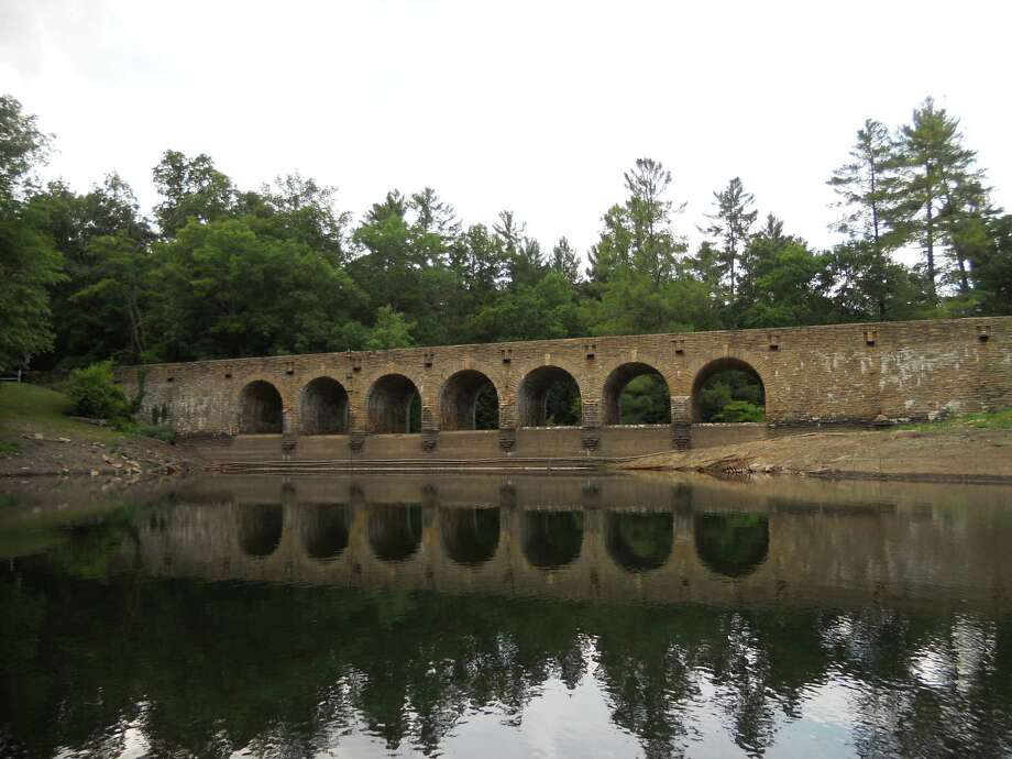 Workers from Cumberland Homesteads built this stone arch bridge and dam on Byrd Lake at Cumberland Mountain State Park. The bridge is among the finest Civilian Conservation Corps projects. Photo: Robin Soslow, For The Express-News