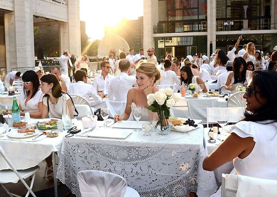 Guests attend the 2012 Diner en Blanc on August 20, 2012 in New York City.  Photo: Andrew H. Walker, Getty Images