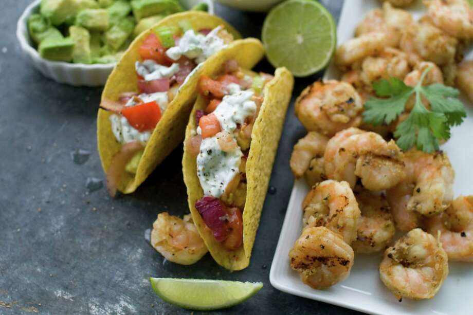 This May 30, 2012 image shows a recipe for grilled shrimp tacos in Concord, N.H. (AP Photo/Matthew Mead) Photo: Matthew Mead / FR170582