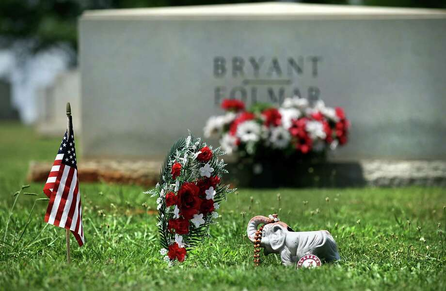 "Alabama Coach Paul ""Bear"" Bryant's grave is adorned with a flag, an elephant, and an Alabama emblem.  He is burried in Birmingham in the Elmwood Cemetery and Mausoleum.  The Texas A&M Aggies, new to the Southeastern Conference, will travel to Auburn, Alabama, Mississippi State and Ole Miss this year.  Monday, July 23, 2012. Photo: BOB OWEN, San Antonio Express-News / © 2012 San Antonio Express-News"