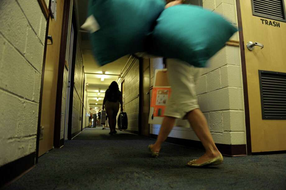 Students and family members carry in their belonging to a dorm room during freshman move-in day at RPI on Tuesday, Aug. 21, 2012 in Troy, NY.  (Paul Buckowski / Times Union) Photo: Paul Buckowski